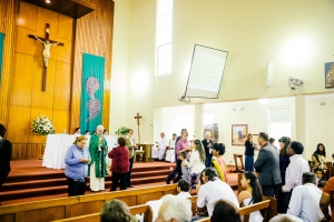 Parishioners coming forward to receive communion