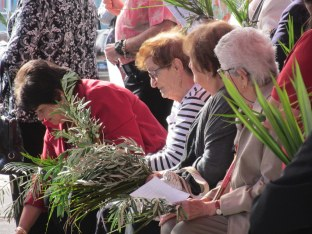 Parishioners with palm and olive branches on Palm Sunday