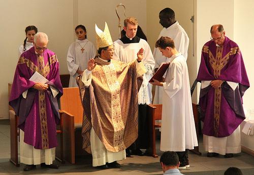 Bishop Vincent Long praying the Solemn Blessing
